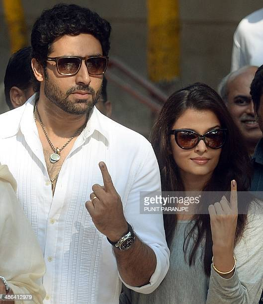 Bollywood actor Abhishek Bachchan and his wife Aishwarya Rai Bachchan pose after casting their votes at a polling station in Mumbai on April 24 2014...