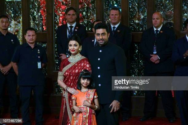 Bollywood actor Abhishek Bachchan with wife Aishwarya Rai Bachchan and daughter Aaradhya arrive to attend the wedding of Mukesh Ambani's daughter...