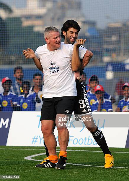 Bollywood actor Aditya roy Kapoor jokes with Dean Windass Hull city Legend in action during an exhibition match played between BPL legends and All...