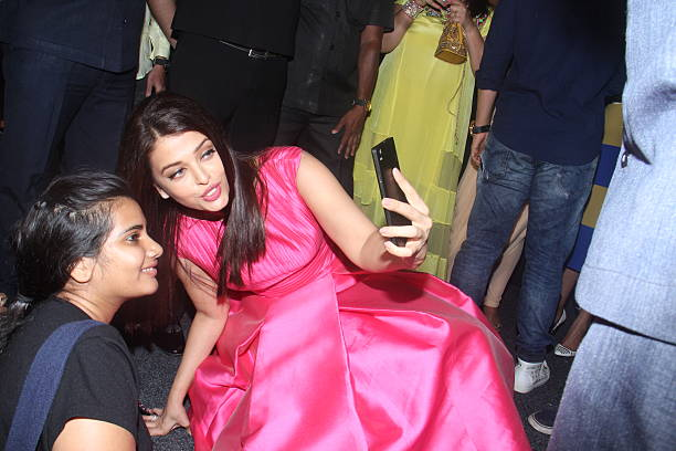 Bollywood actor Aishwarya Rai Bachchan clicking selfie with a fan at the trailer launch of upcoming Bollywood movie Sarbjit at Fun Republic Andheri...