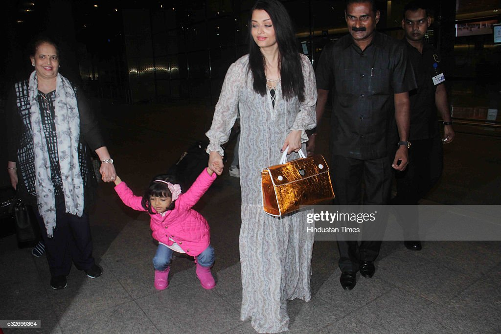 Bollywood actor Aishwarya Rai Bachchan with her daughter Aaradhya Bachchan and mother Brinda Rai returning from Cannes France at airport on May 18...