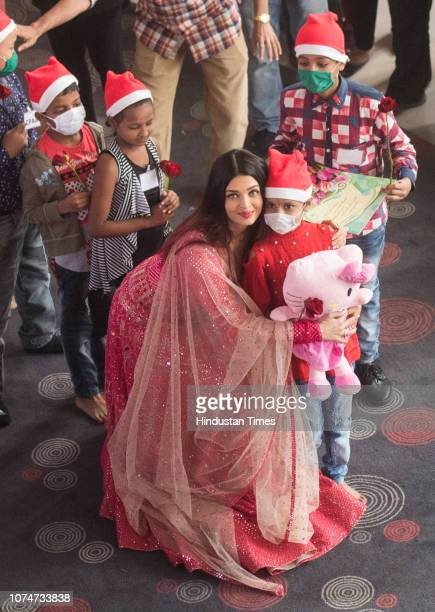 Bollywood actor Aishwarya Rai Bachchan with young cancer patients during a preChristmas celebration organised by Cancer Patient's Aid Association on...