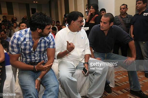 Bollywood actor Ajay Devgan director Priyadarshan along with actor Akshaye Khanna during a promotional event of their upcoming film 'Aakrosh' in New...