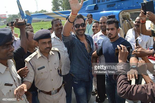 Bollywood actor Ajay Devgn waves to crowd as he arrives to address an election rally for the ongoing Bihar Assembly Elections on October 13 2015 in...