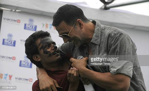 Bollywood actor Akshay Kumar dances with fans during the promotional event of his upcoming movie Gabbar is Back in SGT University on April 24 2015 in...