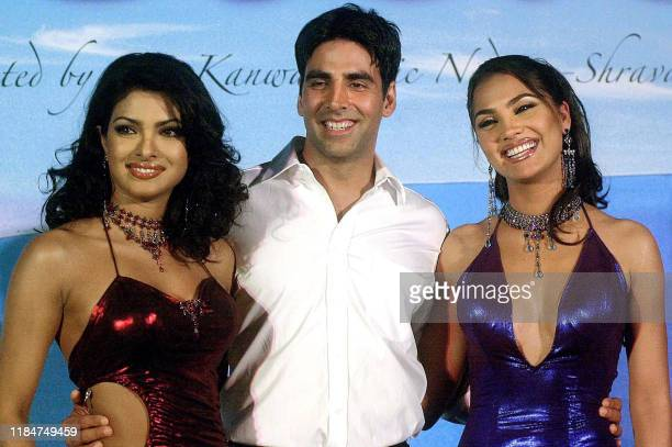 """Bollywood actor Akshay Kumar poses with Lara Dutta and Priyanka Chopra during the launch of the soundtrack of the Hindi movie """"Andaaz"""" in Bombay,..."""