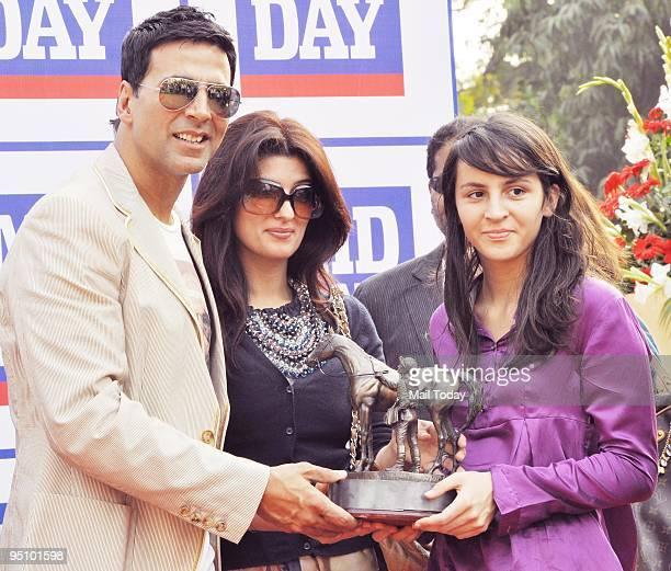 Bollywood actor Akshay Kumar with his wife Twinkle Khanna at the Mahalaxmi Racecourse in Mumbai on December 20 2009