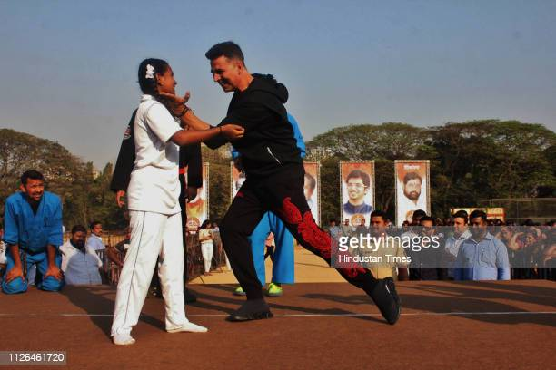 Bollywood actor Akshay Kumar with student after inaugurating a self defence workshop for TMC Girls School students initiated by Thane Municipal...