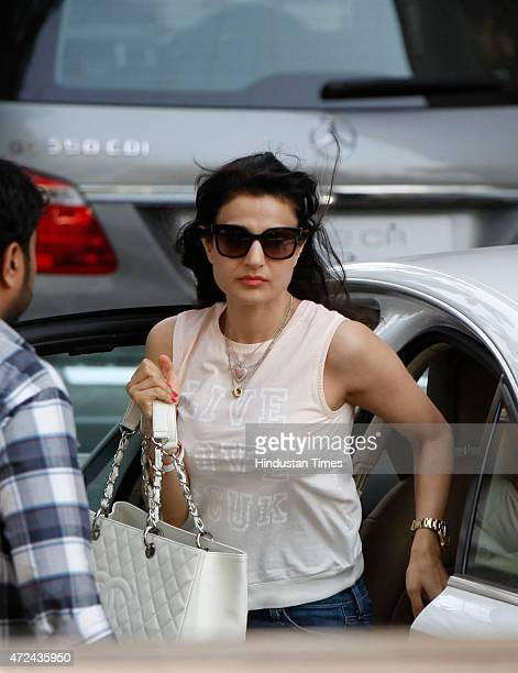 Bollywood actor Ameesha Patel arrives to meet Salman Khan at his residence a day after verdict in hit and run case on May 7 2015 in Mumbai India...