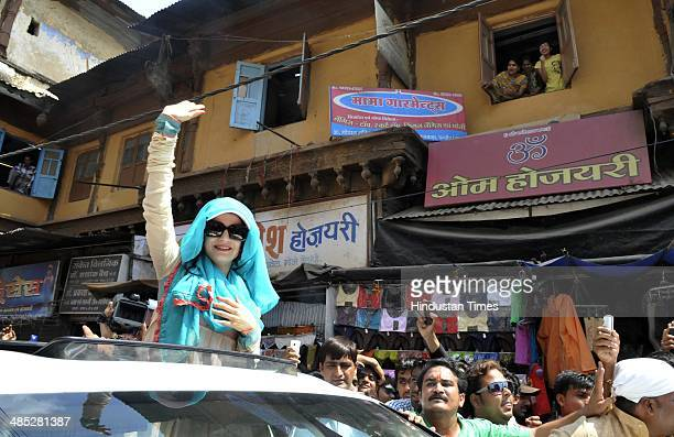 Bollywood actor Ameesha Patel waves at the crowd as she campaigns for Congress candidate Satyanarayan Patel at Rajwada on April 17 2014 in Indore...