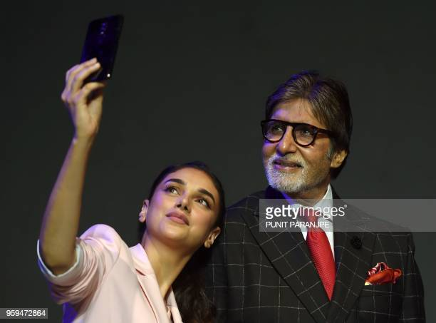 Bollywood actor Amitabh Bachchan and actress Aditi Rao Hydari pose for picture during a commercial event in Mumbai on May 17 2018