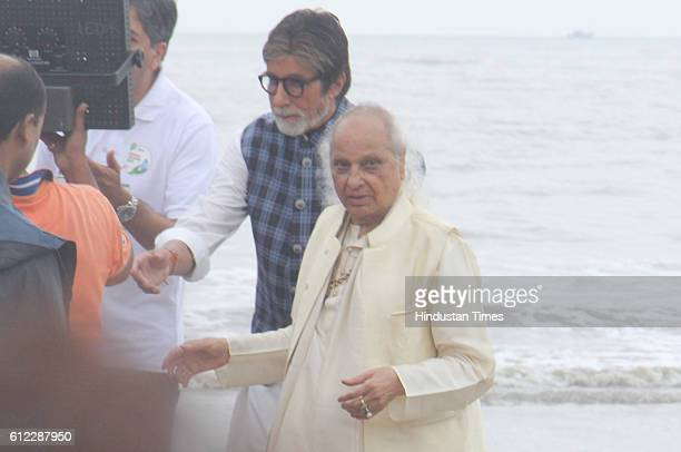 Bollywood actor Amitabh Bachchan and Hindustani classical singer Pandit Jasraj during the 'NDTV Dettol Banega Swachh India' cleanliness drive at Juhu...
