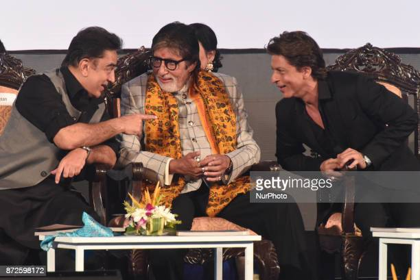 Bollywood actor Amitabh Bachchan center speaks with fellow actor Kamal Hasan and watched by Shah Rukh Khan at the inauguration of the 23rd Kolkata...