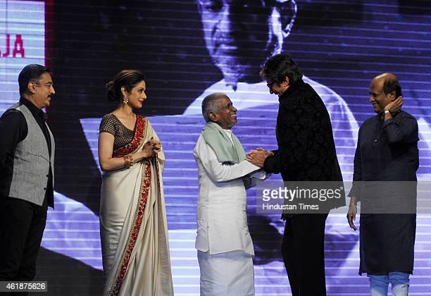Bollywood actor Amitabh Bachchan talks with music director Ilaiyaraaja as actors Kamal Haasan Sridevi and Rajinikanth look on during the trailer...