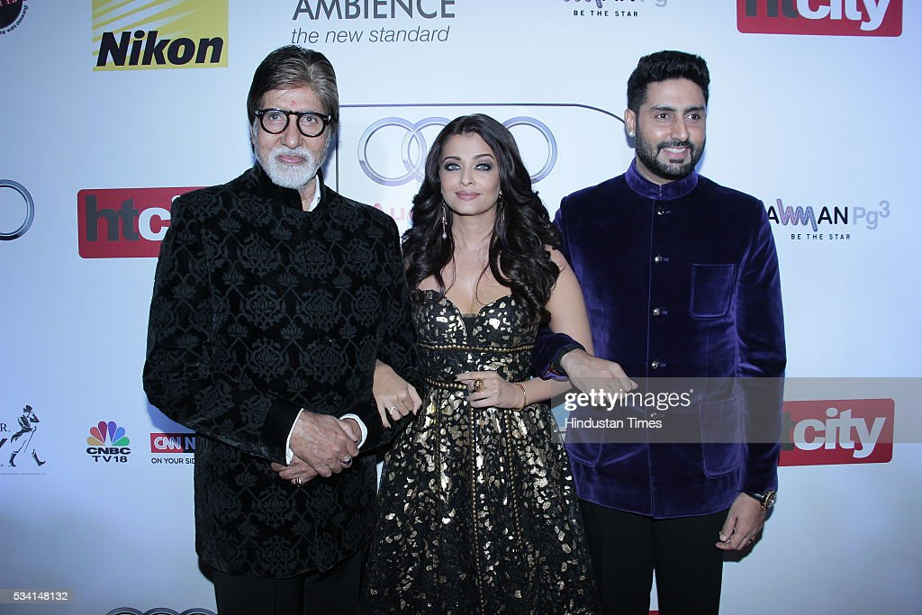 Bollywood actor Amitabh Bachchan with son Abhishek and daughterinlaw Aishwarya Rai Bachchan arriving at red carpet of Hindustan Times Most Stylish...