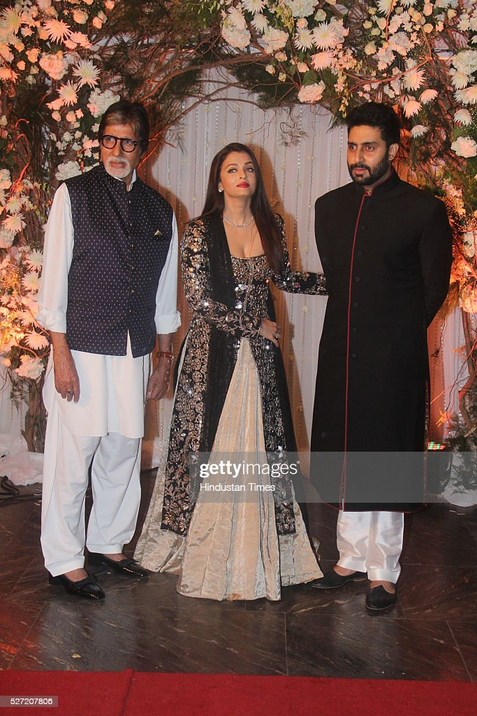 Bollywood actor Amitabh Bachchan with son Abhishek Bachchan and daughterinlaw Aishwarya Rai Bachchan at wedding reception of couple Bipasha Basu and..
