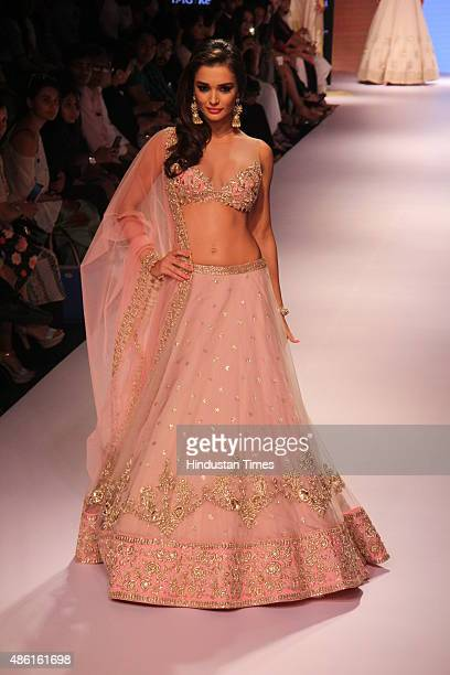 Bollywood actor Amy Jackson walks the ramp displaying an outfit by fashion designer Anushree Reddy during the Lakme Fashion Week Winter/Festive 2015...