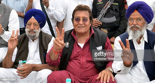 Bollywood actor and BJP Lok Sabha Candidate from Gurdaspur Vinod Khanna with local Akali leaders during a public meeting for election campaign at...