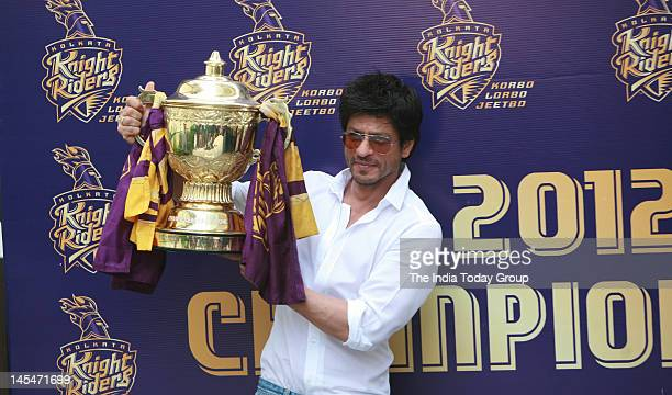 Bollywood actor and coowner of Kolkata Knight Riders Shahrukh Khan holds the IPL 5 trophy during a press conference in Mumbai on Wednesday May 30 2012