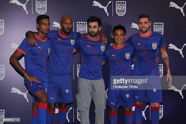 Bollywood actor and coowner of Mumbai City FC Ranbir Kapoor surrounded by Mumbai FC players Subrata Pal Nicolas Anelka Sunil Chhetri and Andre Moritz...