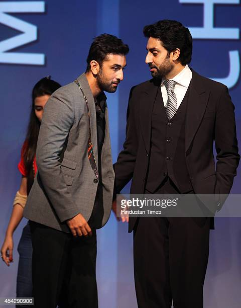 Bollywood actor and coowner of Mumbai City FC Ranbir Kapoor listens to Bollywood actor and coowner of Team Chennai Abhishek Bachchan during the...
