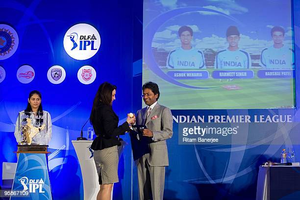 Bollywood actor and coowner of the Kings XI Punjab Preity Zinta stands on stage with the chairman and commissioner Lalit Modi during the Indian...