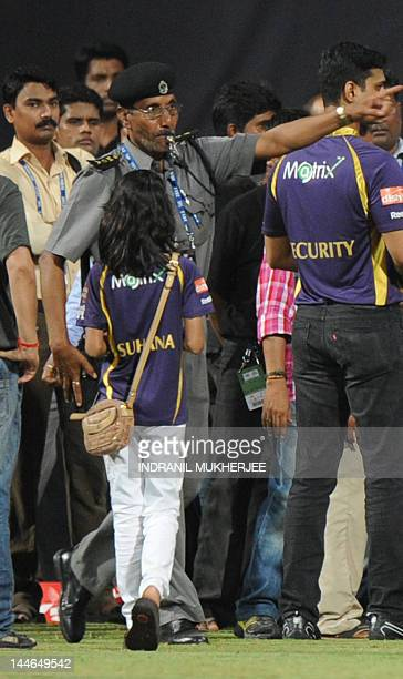 Bollywood actor and Indian Premier League franchise Kolkata Knight Riders coowner Shah Rukh Khan's daughter Suhana watches a security guard blowing a...