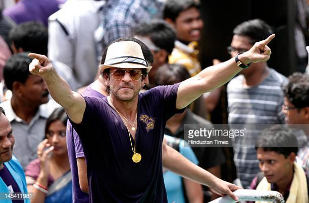 Bollywood actor and Kolkata Knight Riders owner Shah Rukh Khan dances during a celebration ceremony for the Kolkata Knight Riders at Eden Gardens on...