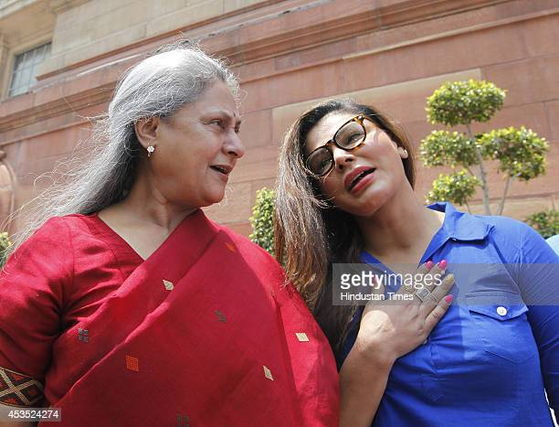 Bollywood actor and SP Rajya Sabha MP Jaya Bachchan with actor Rakhi Sawant at Parliament during budget session on August 12 2014 in New Delhi India...