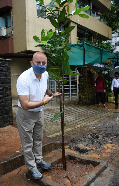 IND: Bollywood Actor Anupam Kher Plants A Tree Sapling Under A Campaign Initiated By MEGA Foundation