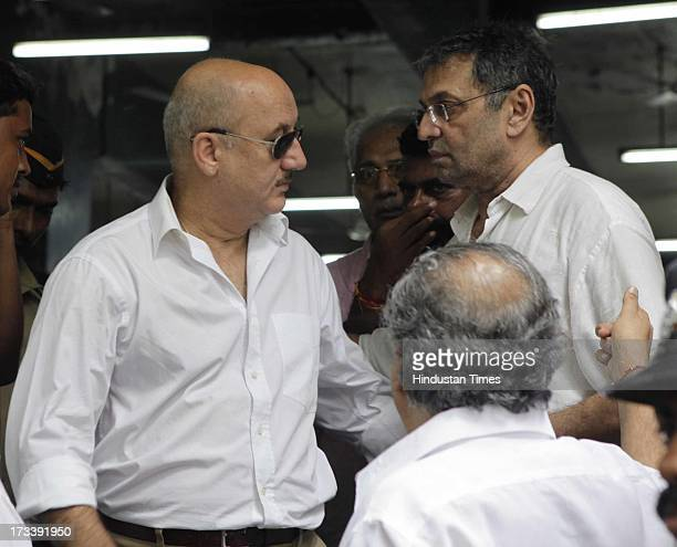 Bollywood actor Anupam Kher with Pran`s son Sunil Sikand during the Bollywood actor Pran cremation at Shivaji Park Crematorium Dadar on July 13 2013...