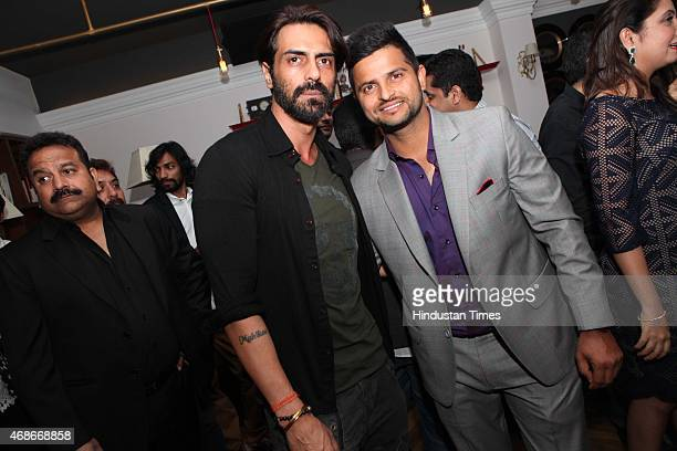 Bollywood actor Arjun Rampal and cricketer Suresh Raina during a prewedding bash of Indian cricketer Suresh Raina hosted by restaurateur Priyank...