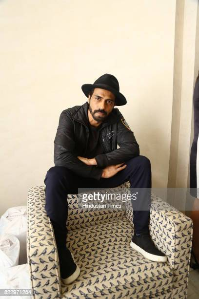 Bollywood actor Arjun Rampal during the first day of India Couture Week 2017 on July 24 2017 in New Delhi India Titled Khush Posh the collection...