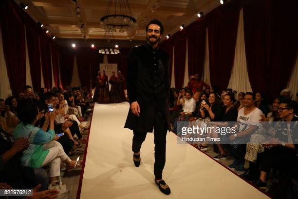 Bollywood actor Arjun Rampal showcasing the couture collection of designer Rohit Bal during the first day of India Couture Week 2017 on July 24 2017...