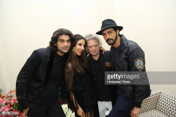 Bollywood actor Arjun Rampal with designer Rohit Bal during the first day of India Couture Week 2017 on July 24 2017 in New Delhi India Titled Khush...