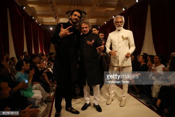 Bollywood actor Arjun Rampal with Rohit Bal and designer Rohit Bal showcasing the couture collection of designer Rohit Bal during the first day of...