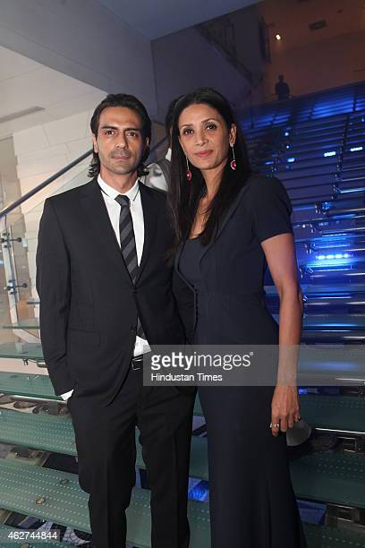 Bollywood actor Arjun Rampal with wife Mehr Jesia Rampal during India Art Fair closing party at Le Meridien on February 1 2015 in New Delhi India