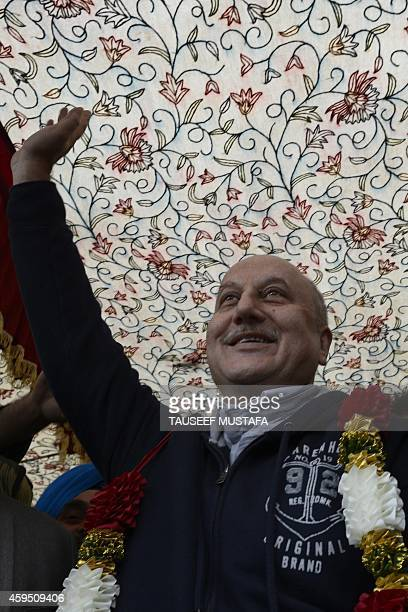 Bollywood actor Aunpam Kher gestures during an election rally by the newly launched Peoples Republician Party in Srinagar on November 24 2014...