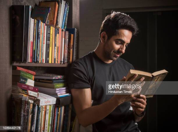 Bollywood actor Ayushmann Khurrana poses during an exclusive interview with Hindustan Times for the World Book Day special at his residence at...
