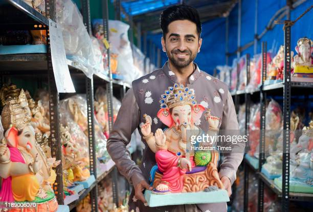 Bollywood actor Ayushmann Khurrana poses with Lord Ganesha's idol on the occasion of Ganeshotsav festival at Juhu Versova Link Road on August 21 2019...
