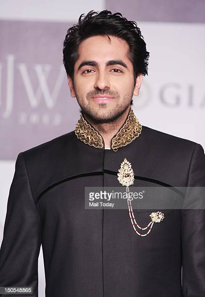 Bollywood actor Ayushmann Khurrana showcases jewellery creations by designer group Jewels By Preeti during the India International Jewellery Week in...