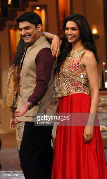Bollywood actor Deepika Padukone with comedian Kapil Sharma during the promotion of film Chennai Express on the sets of Colors TV Serial Comedy...