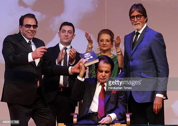 Bollywood actor Dharmendra Aamir Khan Dilip Kumar Saira Banu and Amithabh Bachchan during the launch of Dilip Kumars autobiography The Substance and...