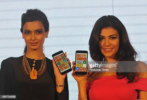 Bollywood actor Diana Panty and Archana Vijaya during the launch of Micromax Canvas Win Series' two window bases phones Canvas Win W121 and Canvas...