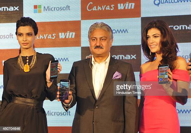 Bollywood actor Diana Panty , Sanjay Kapoor, Chairman Micromax and Archana Vijaya during the launch of Micromax Canvas Win Series' two window bases...
