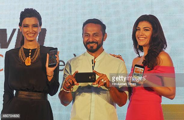 Bollywood actor Diana Panty , VJ Nikhil Chinnapa and Archana Vijaya during the launch of Micromax Canvas Win Series' two window bases phones Canvas...