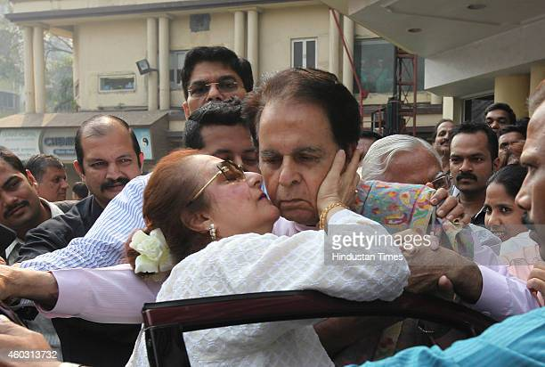 Bollywood actor Dilip Kumar kissed by his wife actress Saira Banu as he steps out of Lilavati Hospital to leave for his home on his 92nd birthday on...