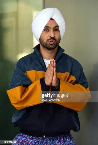 Bollywood actor Diljit Dosanjh gestures as he poses for photographs during the promotion of his upcoming romantic comedy Hindi film 'Arjun Patiala'...