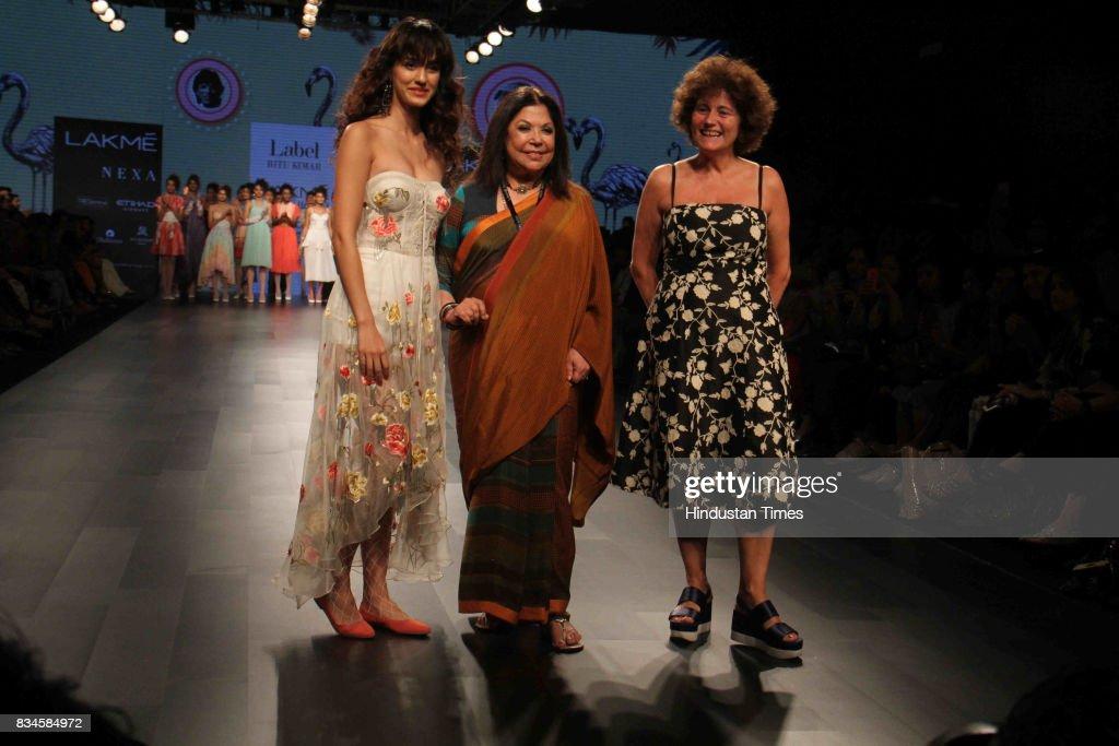 Bollywood actor Disha Patani walks the ramp with designer Ritu Kumar (C) during the Lakme Fashion Week 2017, on August 16, 2017 in Mumbai, India.