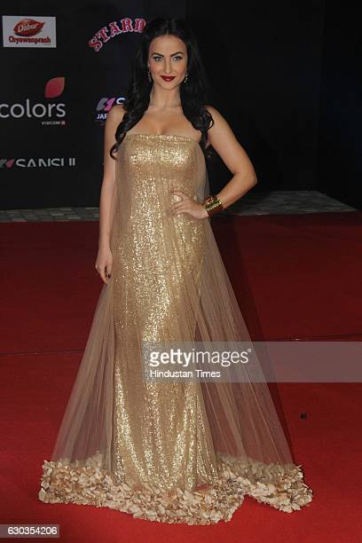 Bollywood actor Elli Avram poses on red carpet for shutterbugs during the Sansui Colors Stardust Awards 2016 on December 19 2016 in Mumbai India